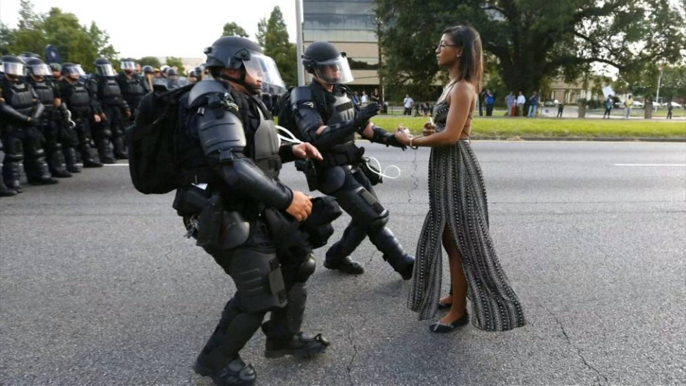 Young black woman about to get arrested